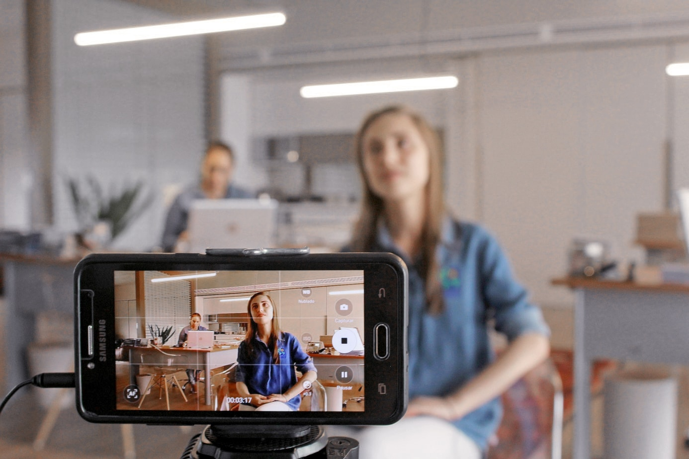 Girl filming video marketing with smartphone