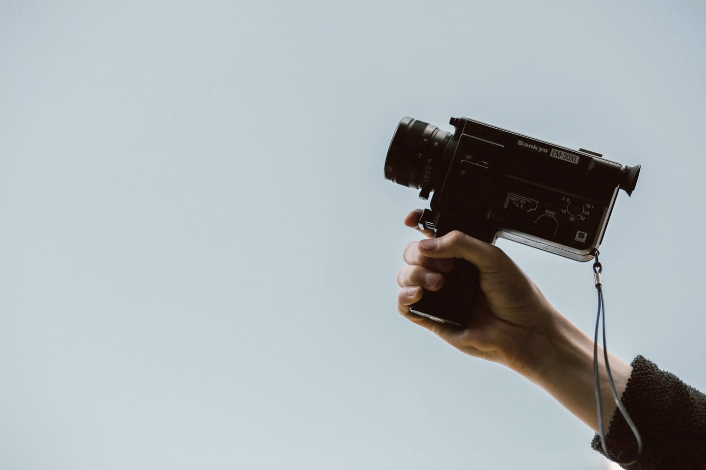Hand holding a video camera that can be used for video marketing